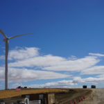 Wind turbine with blue sky in the background