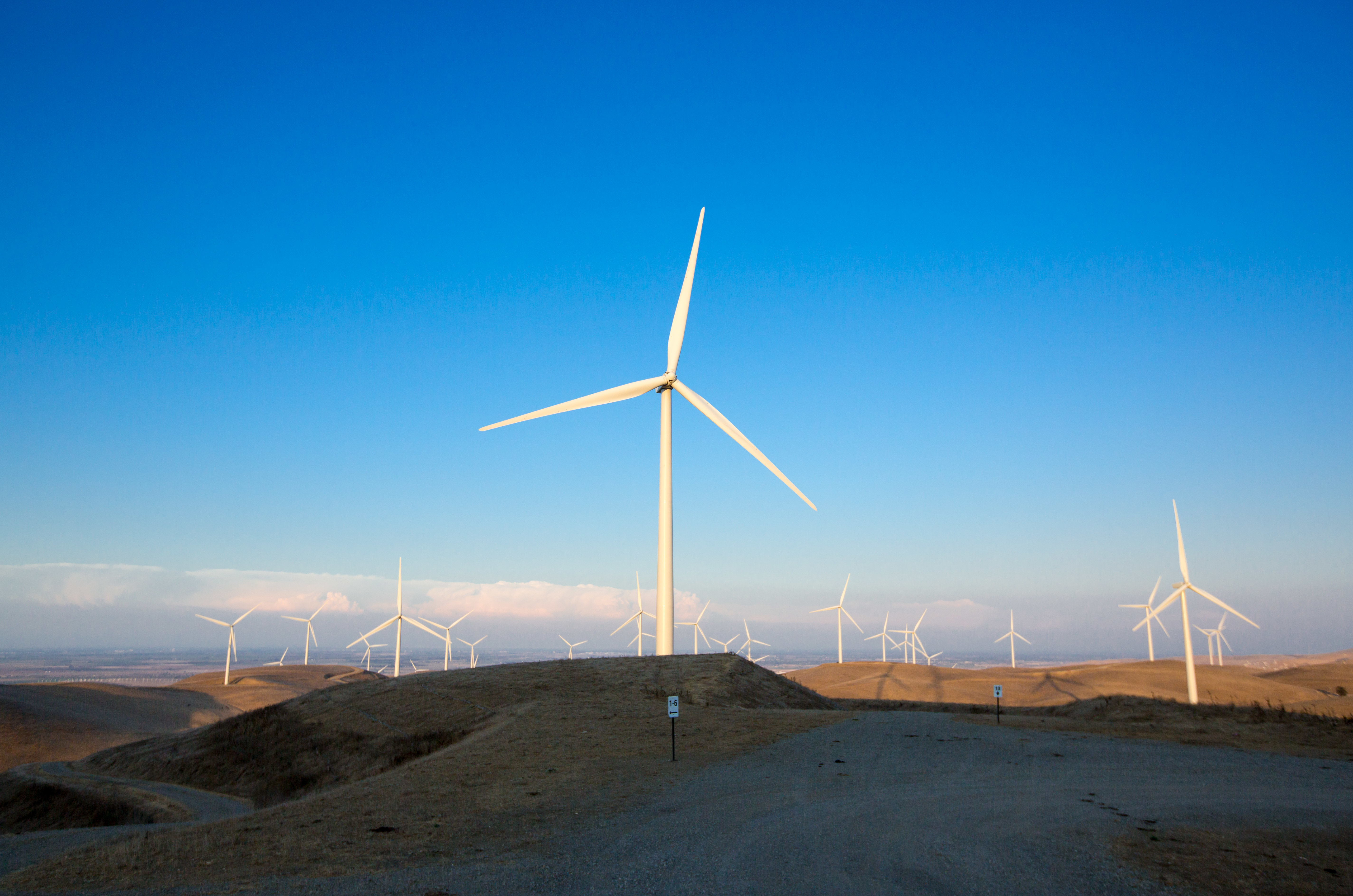 Wind farm with blue sky in the background