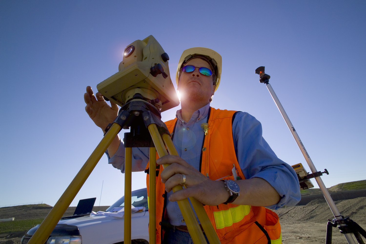 Surveyor with the sun at his back