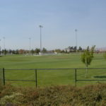 Sports complex with bleachers and lights